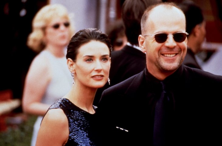 Image Credits: Shutterstock / Everett Collection | Demi Moore, Bruce Willis at the Emmy Awards, 1997.