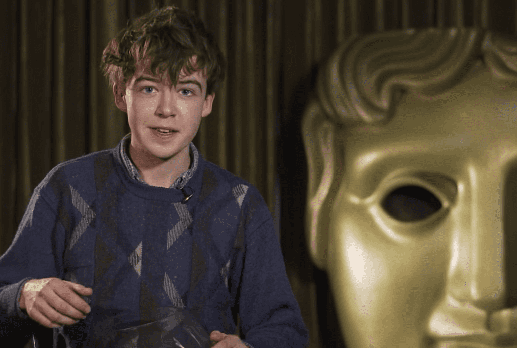Image Source: Youtube/BAFTA Guru| Alex answering questions in BAFTA's show 60 Seconds