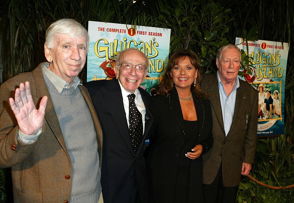 "Image Credit: Getty Images / Cast Members (l-r) Actor Bob Denver, Creator of ""Gilligan's Island"" Sherwood Schwarz Actress Dawn Wells and Actor Russell Johnson arrive at the launch party for ""Gilligan's Island: The Complete First Season"" on February 03, 2004 in Marina del Rey, California."
