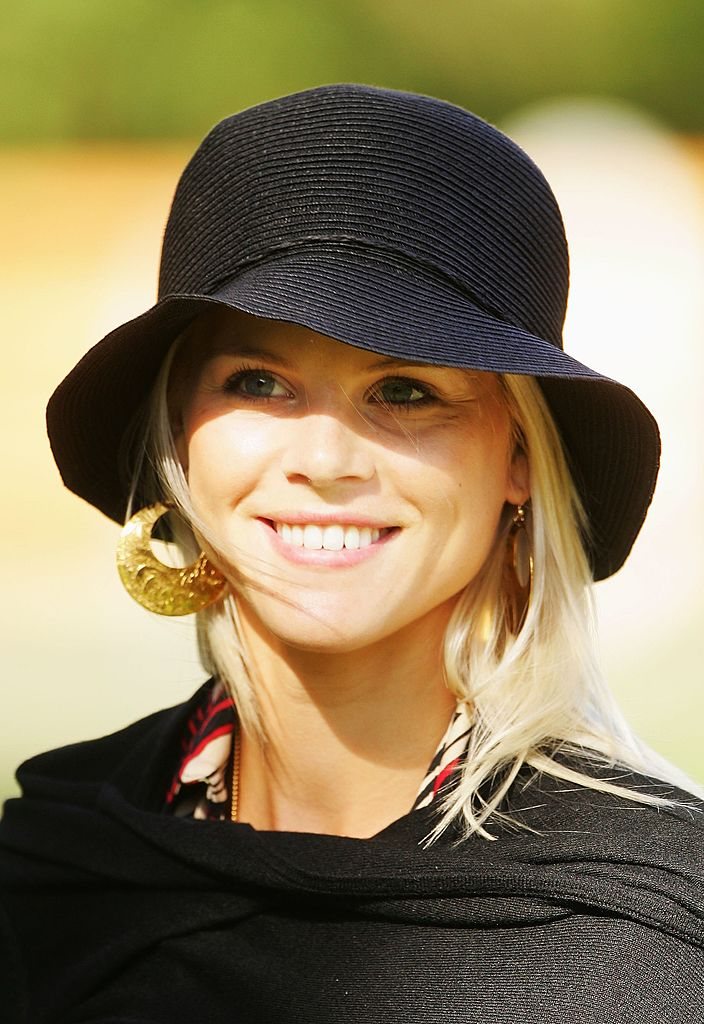 Image Credits: Getty Images / Andrew Redington | Elin Woods smiles as USA and European team wives prepare to travel to The Curragh racecourse for the Wives Race Day prior to the start of the 2006 Ryder Cup at The K Club on September 19, 2006 in Straffan, Co. Kildare, Ireland.