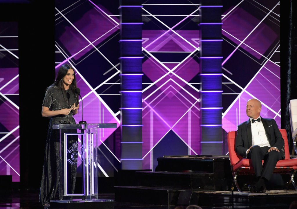 Image Source: Getty Images/Neilson Barnard/VMN18/Bruce Willis (R) reacts while Demi Moore speaks onstage during the Comedy Central Roast of Bruce Willis at Hollywood Palladium on July 14, 2018 in Los Angeles, California