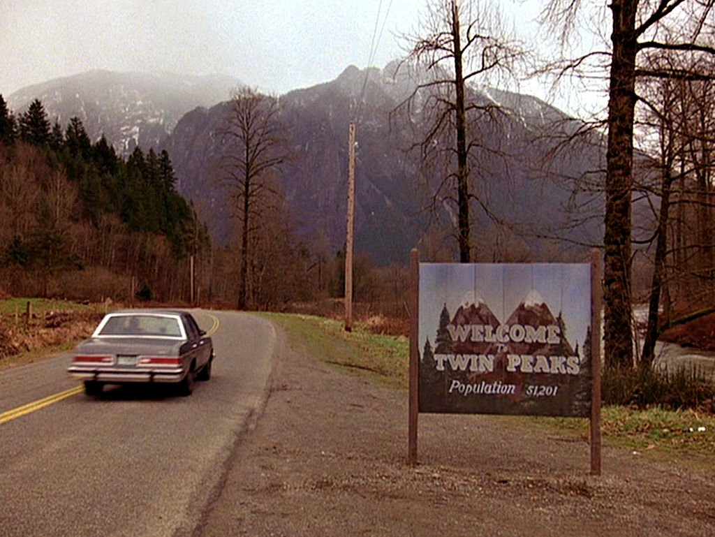 Image Credits: Getty Images / CBS Photo Archive | The title scene from the pilot episode of the television series 'Twin Peaks,' originally broadcast on April 8, 1990. It was filmed on Reinig Road in Snoqualmie, Washington.