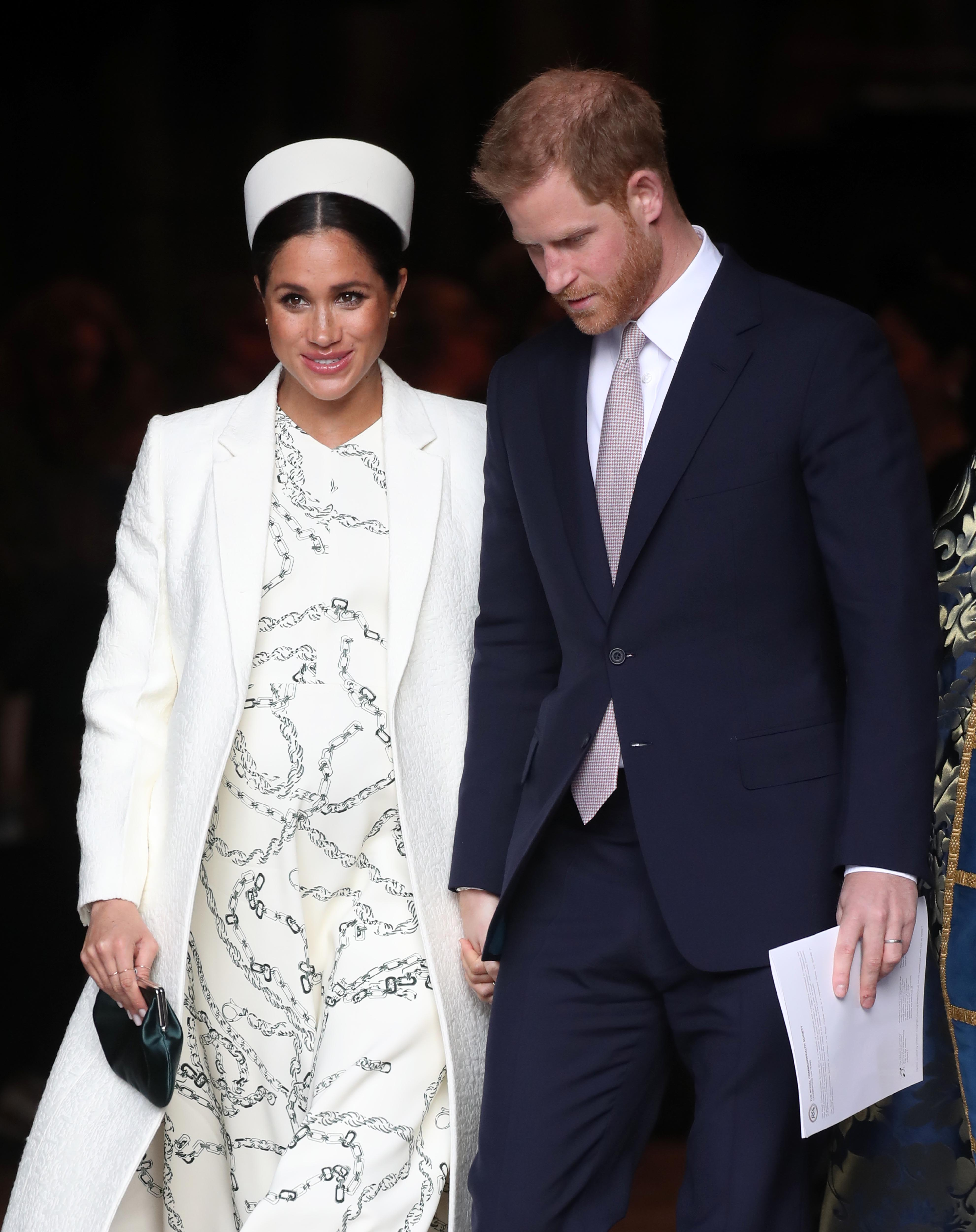 Image Credits: Getty Images | Prince Harry and Meghan Markle are photographed on a royal trip.