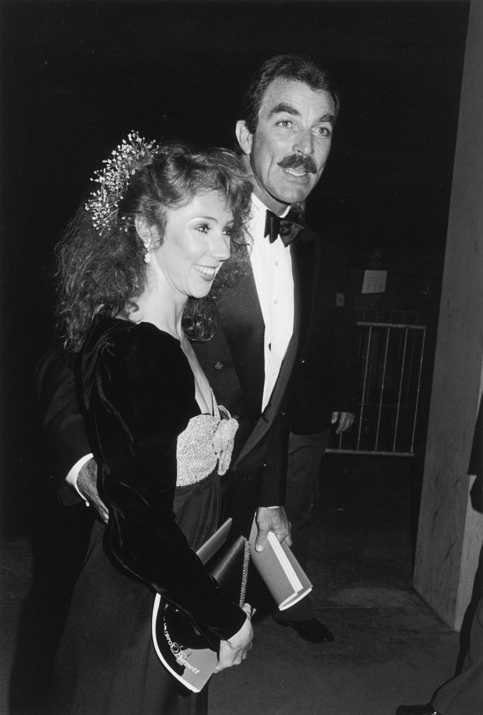 Image Source: Getty Images / Darlene Hammond | American actor Tom Selleck and his girlfriend, Jillie Mack, attend a Tribute to Carol Burnett on the UCLA campus, Los Angeles, California.