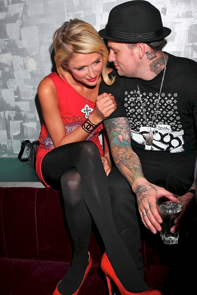 Image Credits: Getty Images / JAB Promotions / WireImage | Paris Hilton and Benji Madden at Crystal Nightclub on April 15, 2008 in London, England.