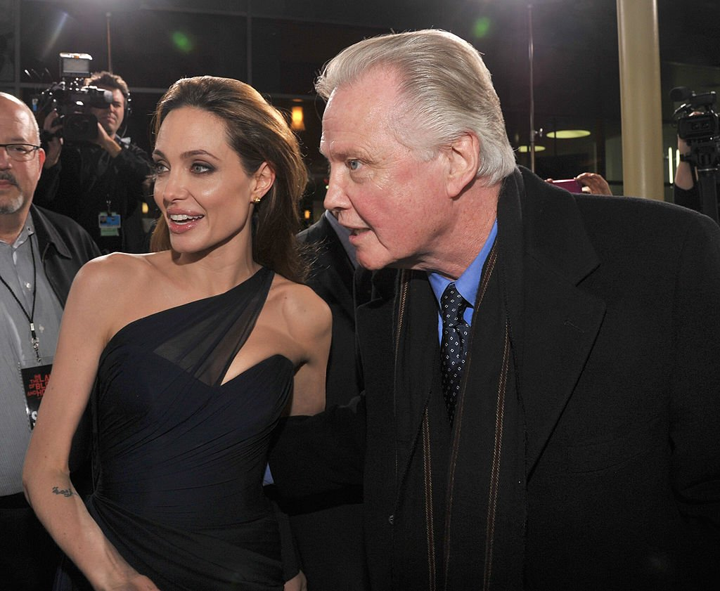 "Image Source: Getty Images/Lester Cohen/Writer/Director Angelina Jolie (L) and actor Jon Voight arrives at the ""In the Land of Blood and Honey"" premiere held at ArcLight Cinemas on December 8, 2011 in Hollywood, California"