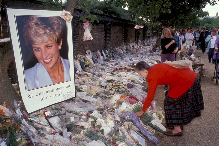 Image Credit: Getty Images/Universal Images Group Editorial | Flowers and tributes for the late Princess Diana outside Kensington Palace