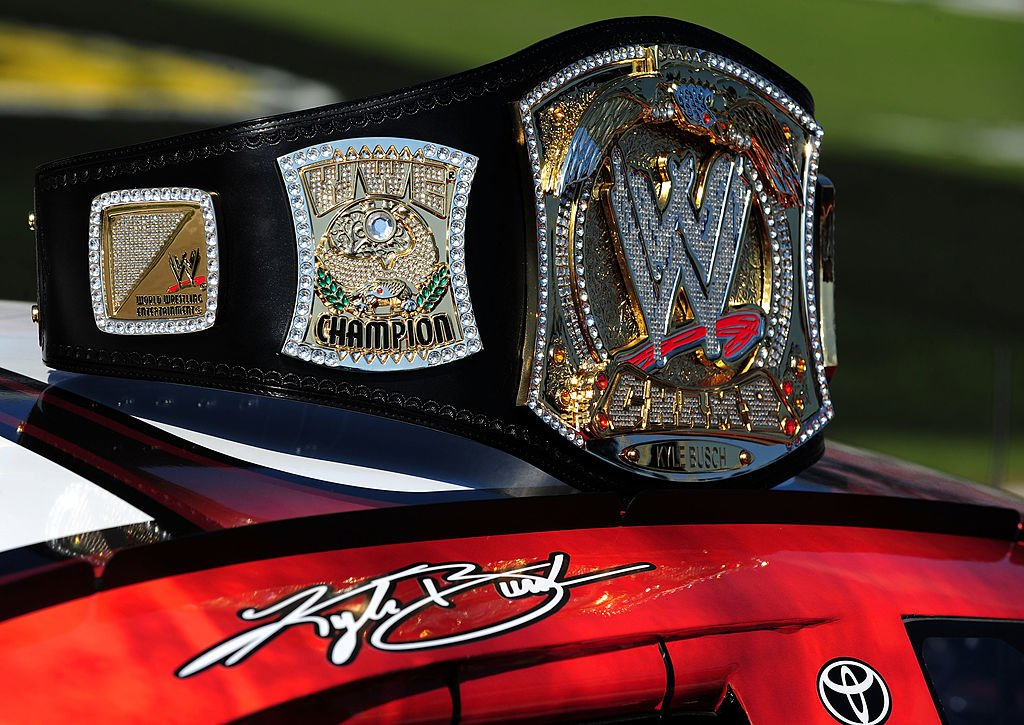 Image Credits: Getty Images / Robert Laberge | A replica of the WWE world championship belt rests on top of Kyle Busch's #18 Z-Line Designs/WWE Smackdown Toyota prior to the start of the NASCAR Nationwide Series O'Reilly Challenge at Texas Motor Speedway on November 7, 2009 in Fort Worth, Texas.