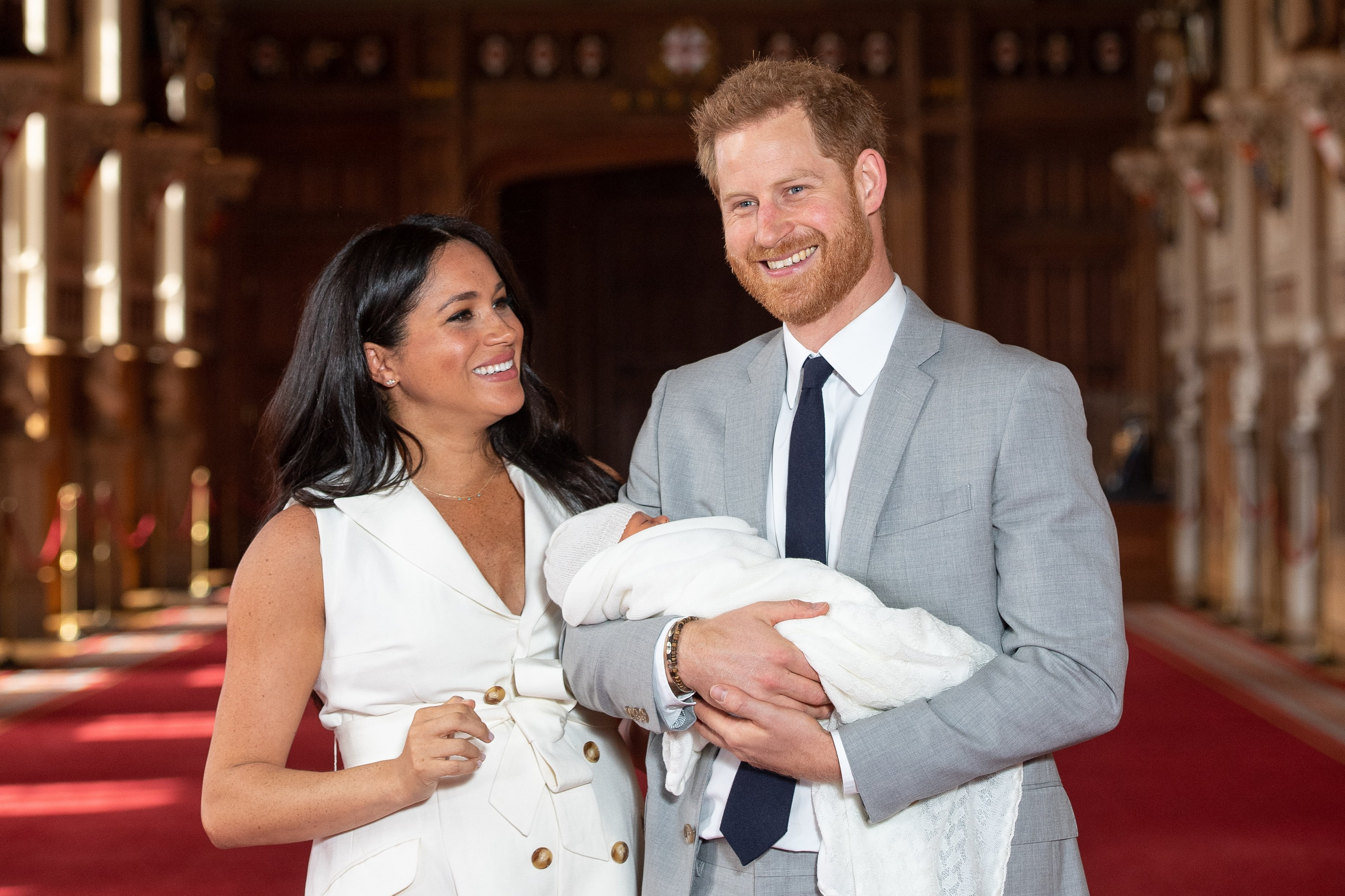 Image Credits: Getty Images /  Dominic Lipinski - WPA Pool   Prince Harry, Duke of Sussex and Meghan, Duchess of Sussex, pose with their newborn son Archie Harrison Mountbatten-Windsor during a photocall in St George's Hall at Windsor Castle on May 8, 2019 in Windsor, England. The Duchess of Sussex gave birth at 05:26 on Monday 06 May, 2019.