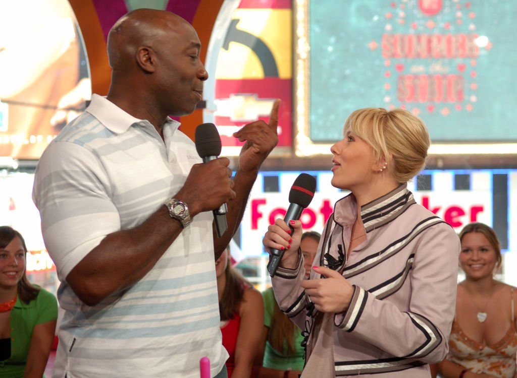 "Image Credit: Getty Images / Michael Clarke Duncan and Scarlett Johansson during Scarlett Johansson, Michael Clarke Duncan and The All-American Rejects Visit MTV's ""TRL"" - July 11, 2005 at MTV Studios - Times Square in New York City, New York, United States."