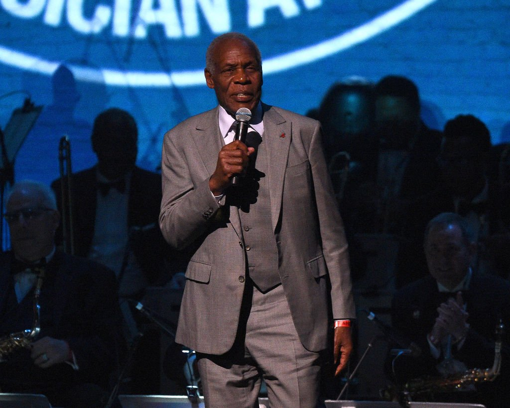 Image Source: Getty Images/Theo Wargo| Danny Glover speaks the 17th Annual A Great Night In Harlem at The Apollo Theater on April 04, 2019 in New York City