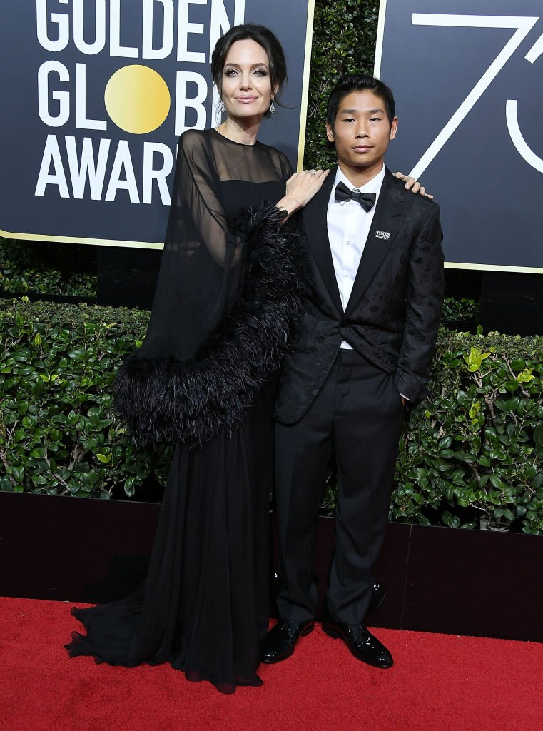 Image Source: Getty Images/Steve Granitz/Angelina Jolie, Pax Thien Jolie-Pitt arrives at the 75th Annual Golden Globe Awards at The Beverly Hilton Hotel on January 7, 2018 in Beverly Hills, California