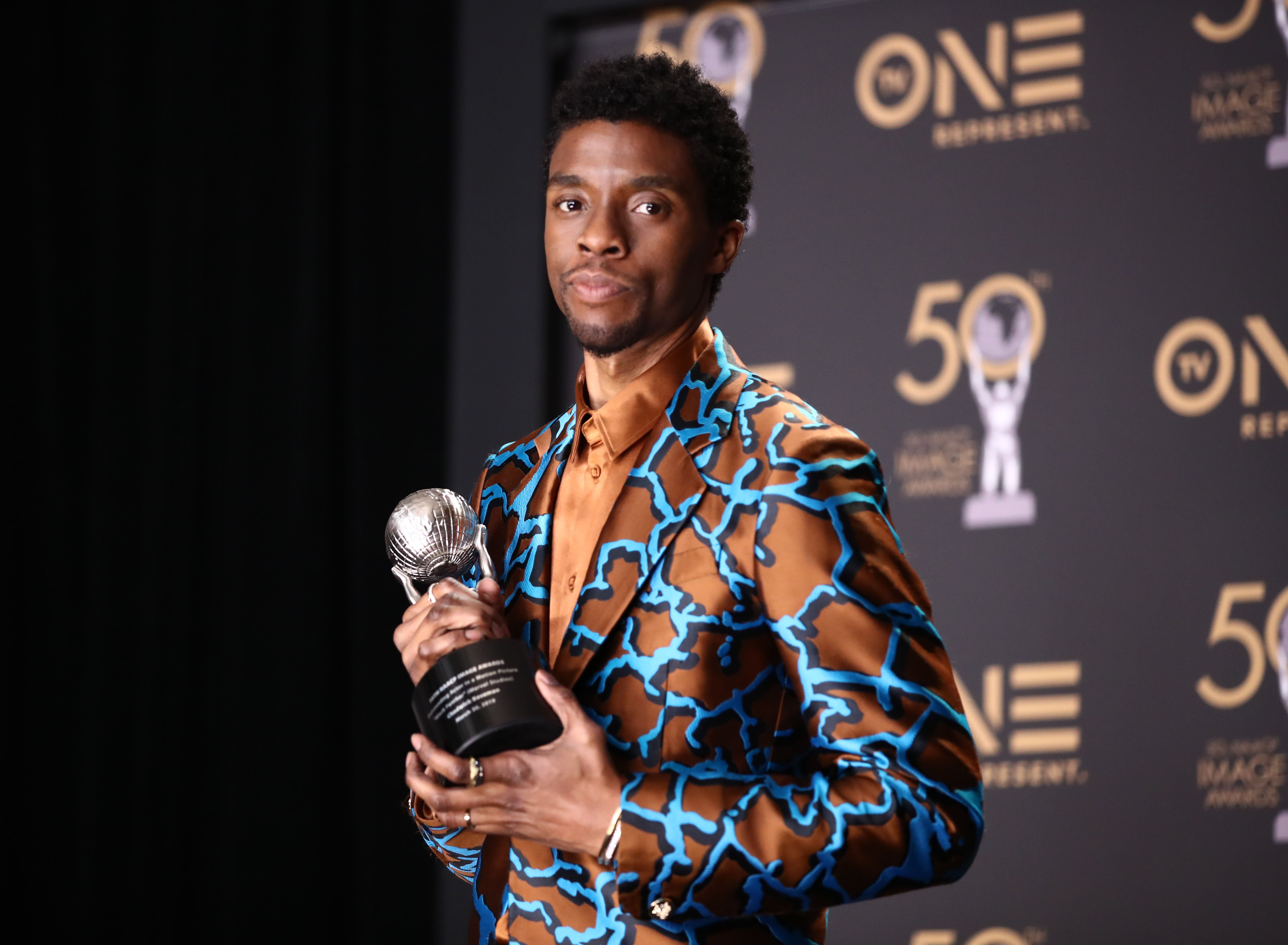 Image Credits: Getty Images / Rich Fury / FilmMagic | Chadwick Boseman, winner of Outstanding Actor in a Motion Picture, attends the 50th NAACP Image Awards at Dolby Theatre on March 30, 2019 in Hollywood, California.