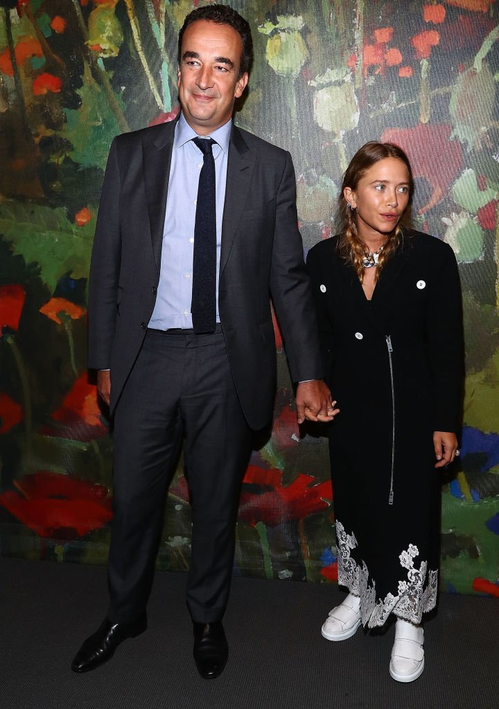 Image Credit: Getty Images/Astrid Stawiarz | Olivier Sarkozy and Mary-Kate Olsen attend 2017 Take Home A Nude Art