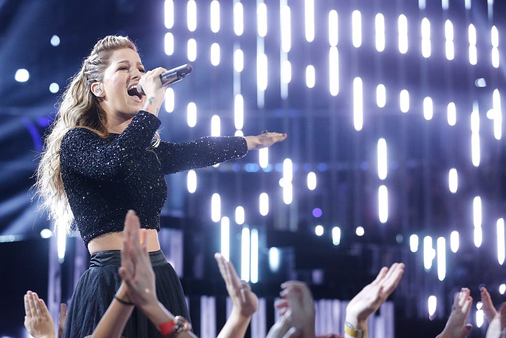 Image Source: Getty Images/NBCU Photo Bank/NBCUniversal via Getty Images/Trae Patton | Cassadee Pope performs during the live semis of The Voice Season 9
