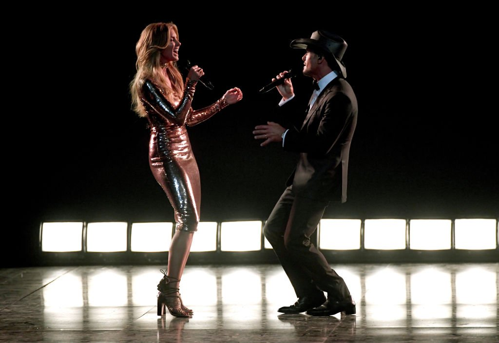 Image Credits: Getty Images / Ethan Miller | Recording artists Faith Hill (L) and Tim McGraw perform onstage during the 52nd Academy of Country Music Awards at T-Mobile Arena on April 2, 2017 in Las Vegas, Nevada.