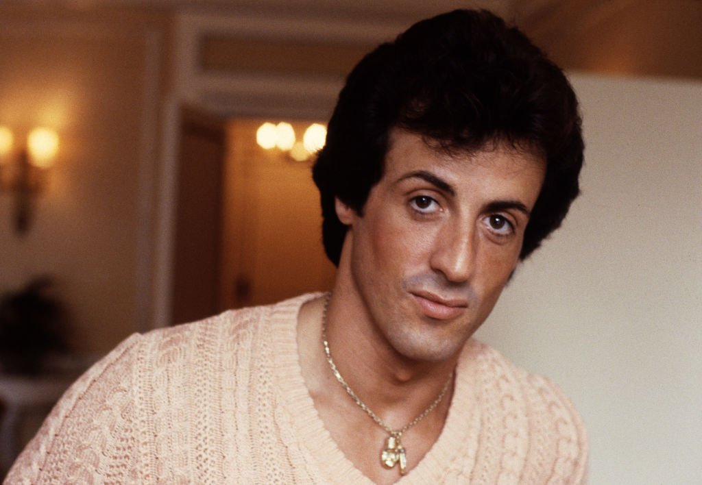 Image Source: Getty Images/Michael Putland | Photo of Stallone circa 1982