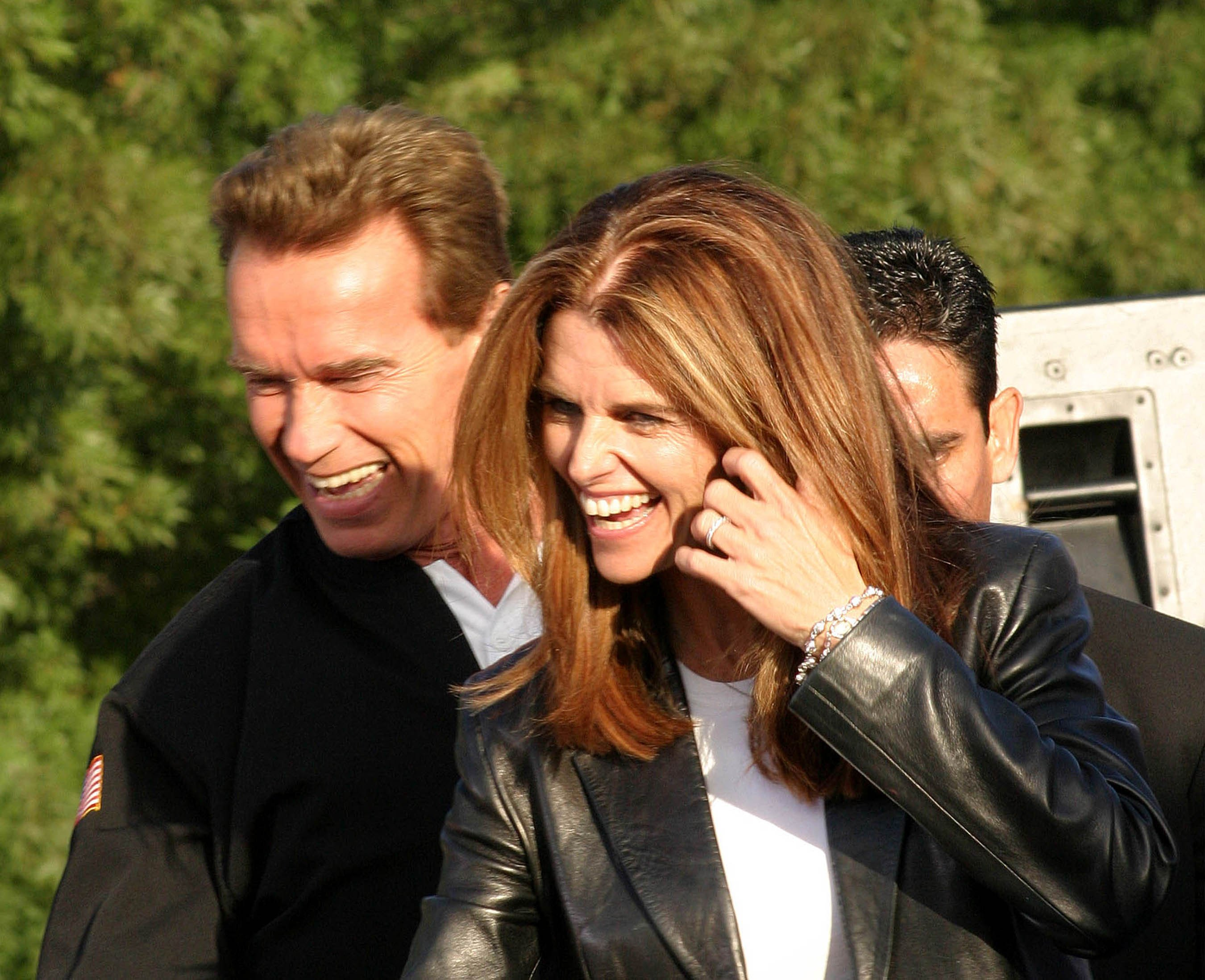 Image Credits: Shutterstock / Joe Seer | Arnold Schwarzenegger, Maria Shriver at the CA Comeback Express Bus Tour in Pleasanton, CA on October 4, 2003.