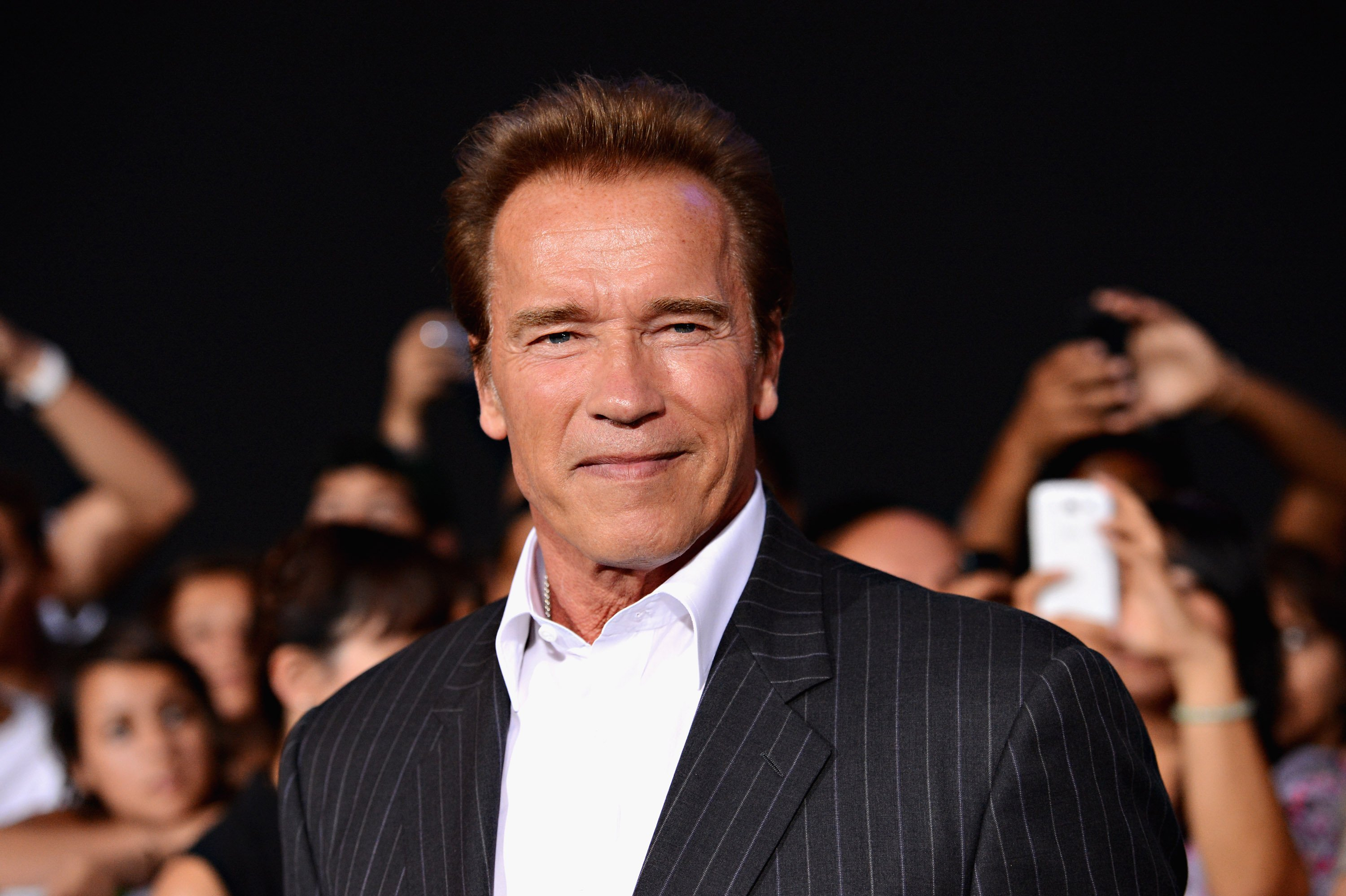 "Image Credits: Getty Images / Jason Merritt | Actor Arnold Schwarzenegger arrives at Lionsgate Films' ""The Expendables 2"" premiere on August 15, 2012 in Hollywood, California."