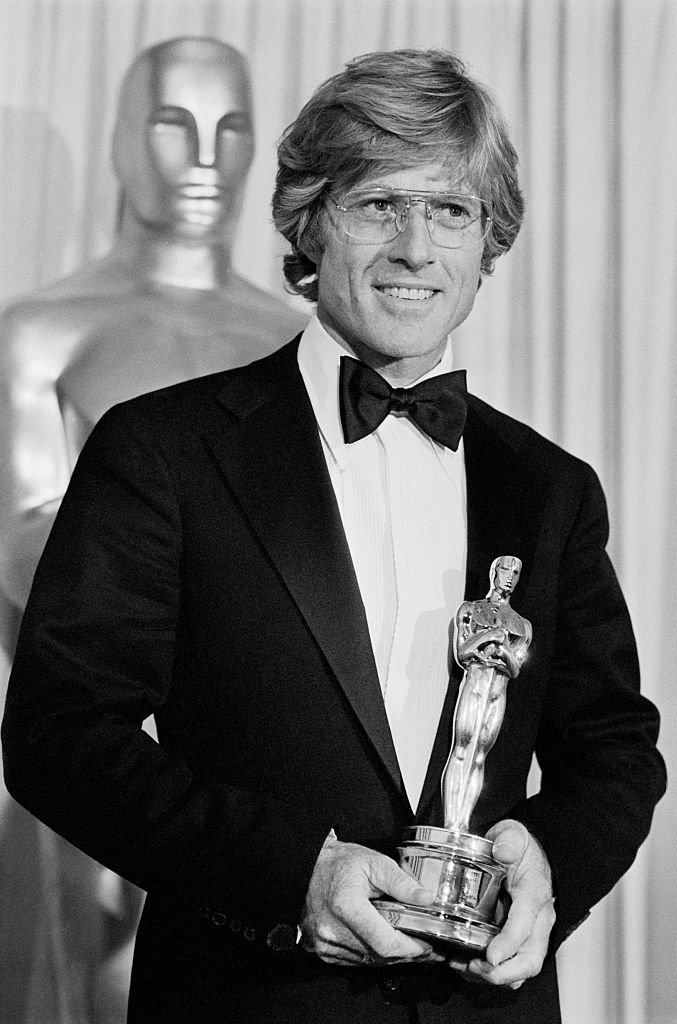 Image Credits: Getty Images / Bettmann | Robert Redford admires his Oscar after he won it for Best Achievement for Directing in the movie, Ordinary People. The Oscar was one of the two top awards won by the film, the second being the Best Picture award.