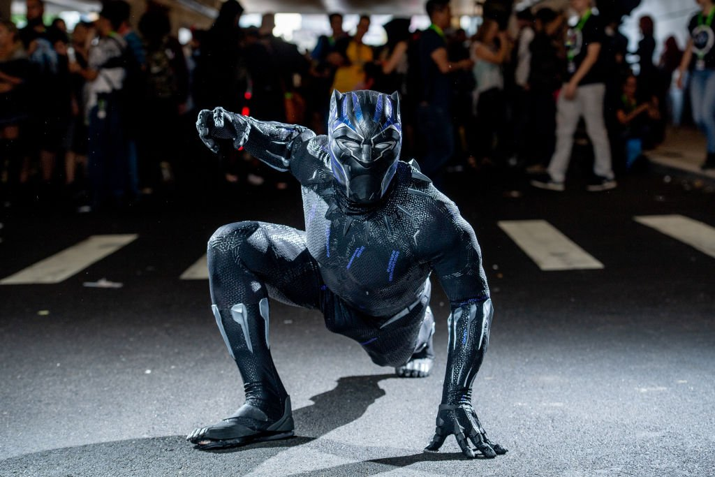 Image Credits: Getty Images / Roy Rochlin | A fan cosplays as Black Panther from the Marvel Universe during the 2018 New York Comic-Con at Javits Center on October 7, 2018 in New York City.