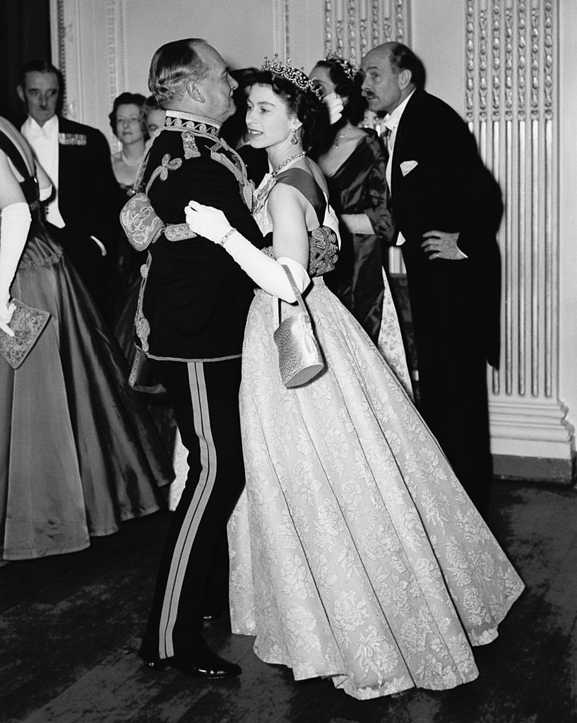 Queen Elizabeth II dancing with Air Marshal Sir John Baldwin, colonel of the 8th Hussars. | Source: Getty Images