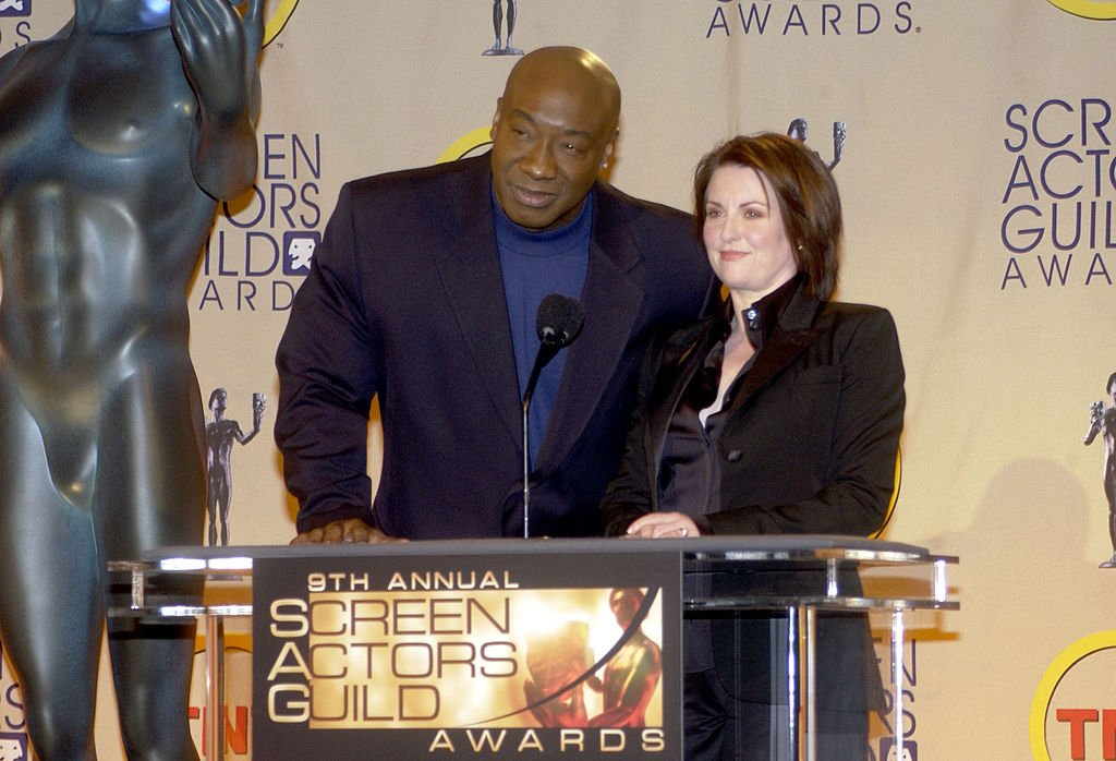 Image Credit: Getty Images / Michael Clarke Duncan and Megan Mullally during Ninth Annual Screen Actors Guild Awards - Nominations Press Conference at Skirball Cultural Center in Los Angeles, California, United States.
