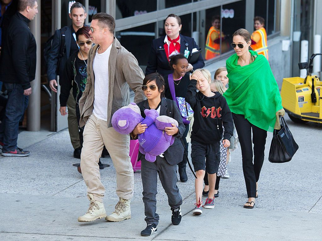 Brad Pitt and Angelina Jolie are seen after landing at Los Angeles International Airport with their children, Pax Jolie-Pitt, Maddox Jolie-Pitt, Shiloh Jolie-Pitt, Zahara Jolie-Pitt, Vivienne Jolie-Pitt and Knox Jolie-Pitt on February 05, 2014 in Los Angeles, California. (Photo by GVK/Bauer-Griffin/GC Images)
