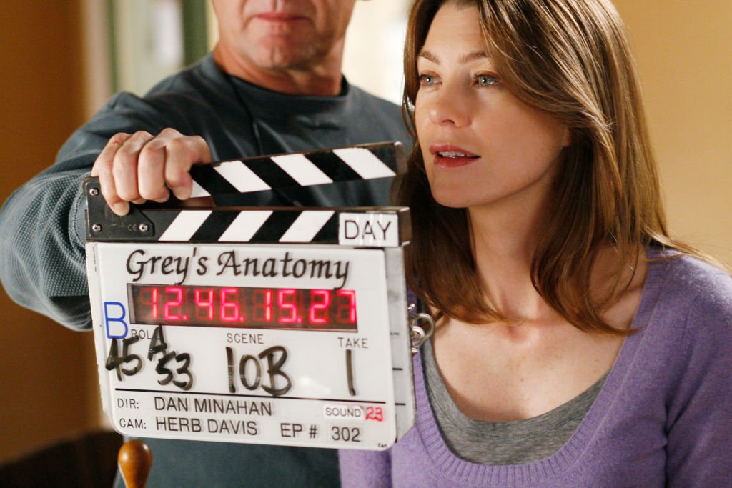 Image Credit: Getty Images/Walt Disney Television via Getty Images/Ron Tom | BTS photo of Ellen Pompeo from Grey's Anatomy