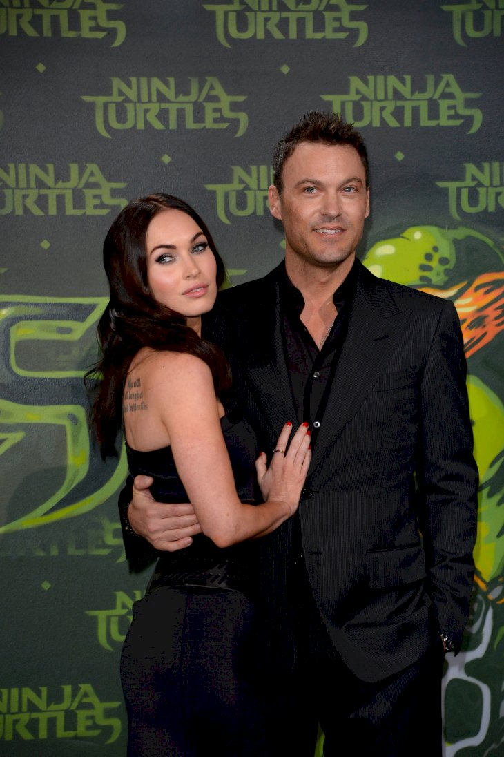 Megan Fox and Brian Austin Green attend the Berlin premiere of the film 'Teenage Mutant Ninja Turtles' / Getty Images
