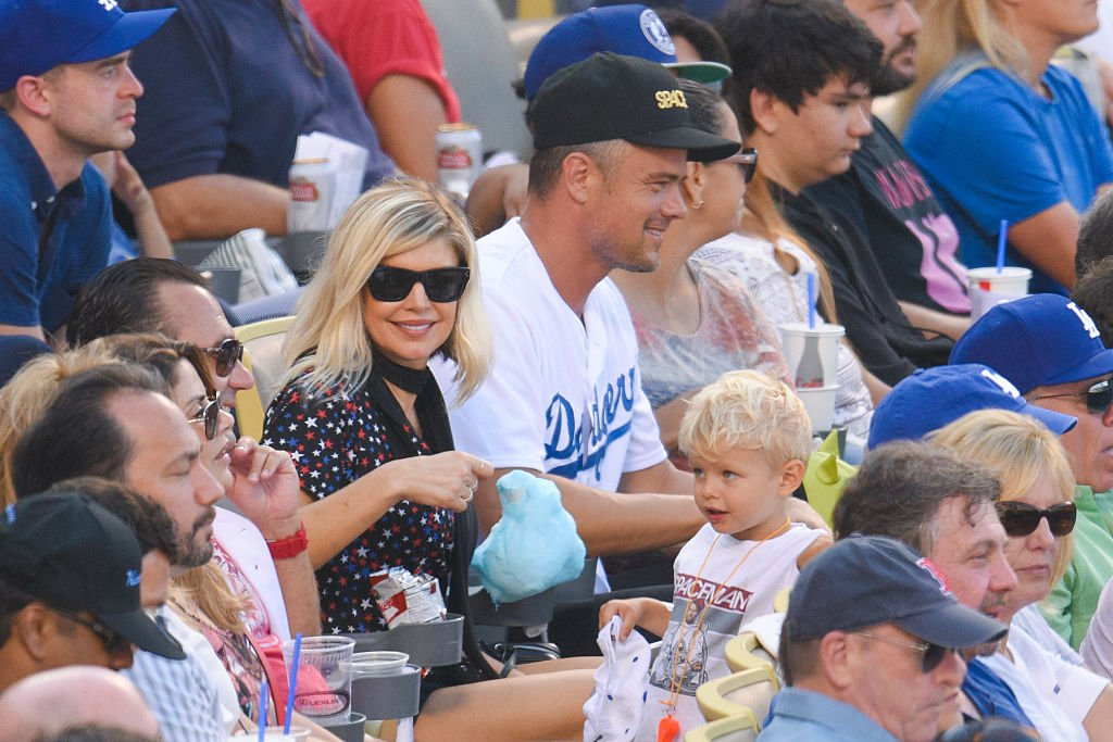 Image Credit: Getty Images / Fergie, Josh Duhamel and Axl Jack Duhamel attend a baseball game at Dodger Stadium on August 7, 2016 in Los Angeles.