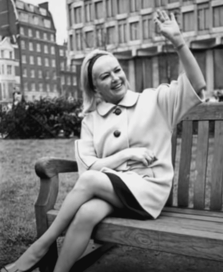 Image Source: Youtube/Stacey| Betty waving and sitting on a bench