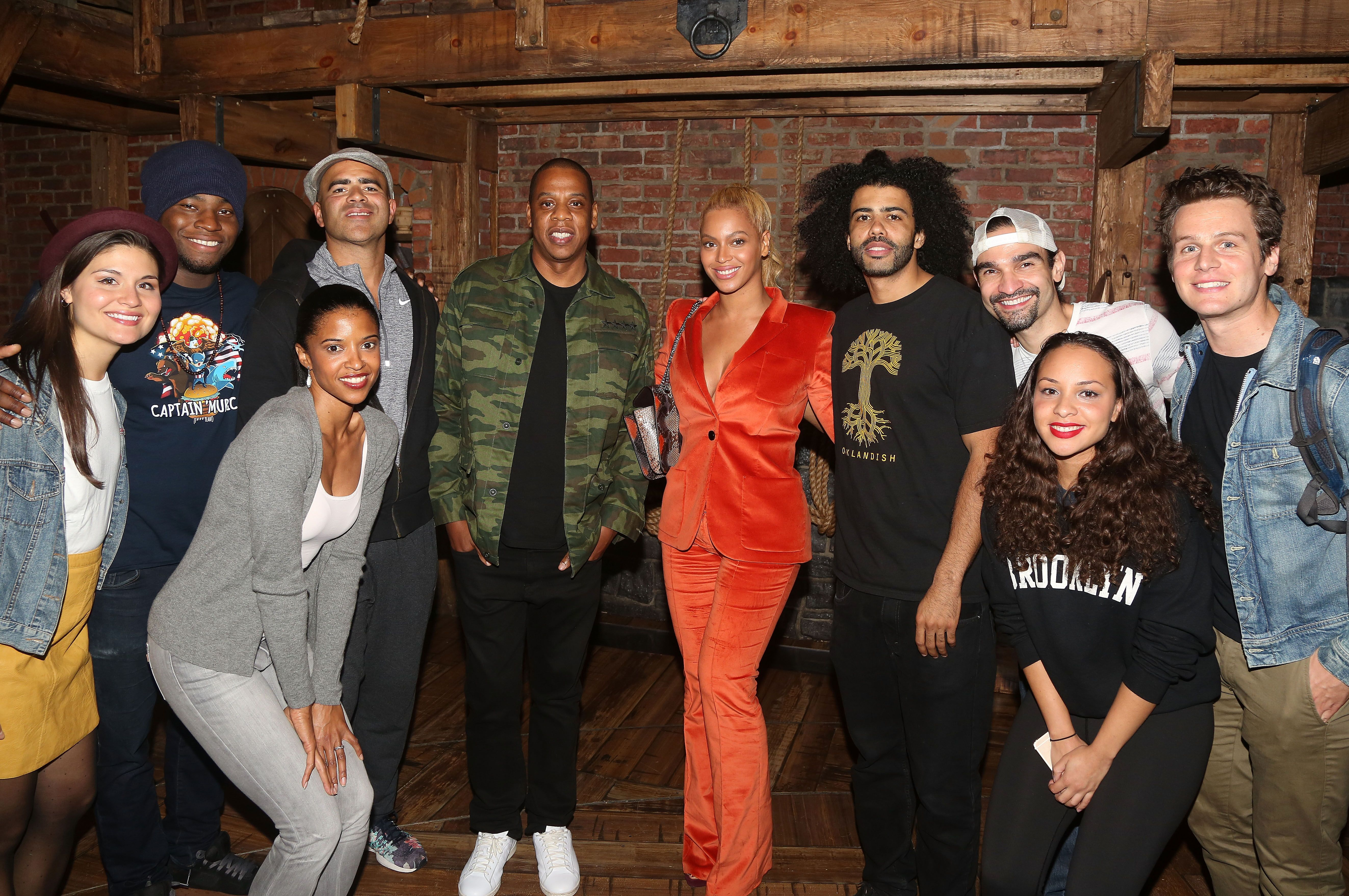 """Stars pose backstage at the hit musical """"Hamilton"""" on Broadway / Getty Images"""