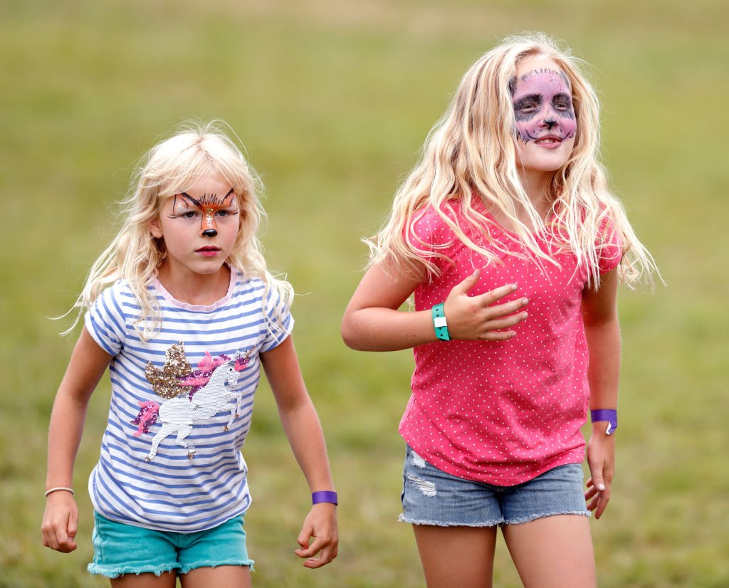 Image Credit: Getty Images / Isla Phillips and Savannah Phillips, seen wearing animal design face paint at Gatcombe Park on August 4, 2019 in Stroud, England.