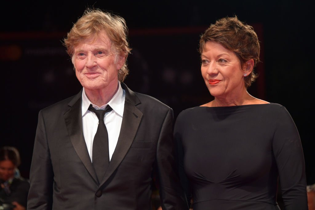 Image Credits: Getty Images / Dominique Charriau / WireImage | Robert Redford and Sibylle Szaggars walk the red carpet ahead of the 'Our Souls At Night' screening during the 74th Venice Film Festival at Sala Grande on September 1, 2017 in Venice, Italy.