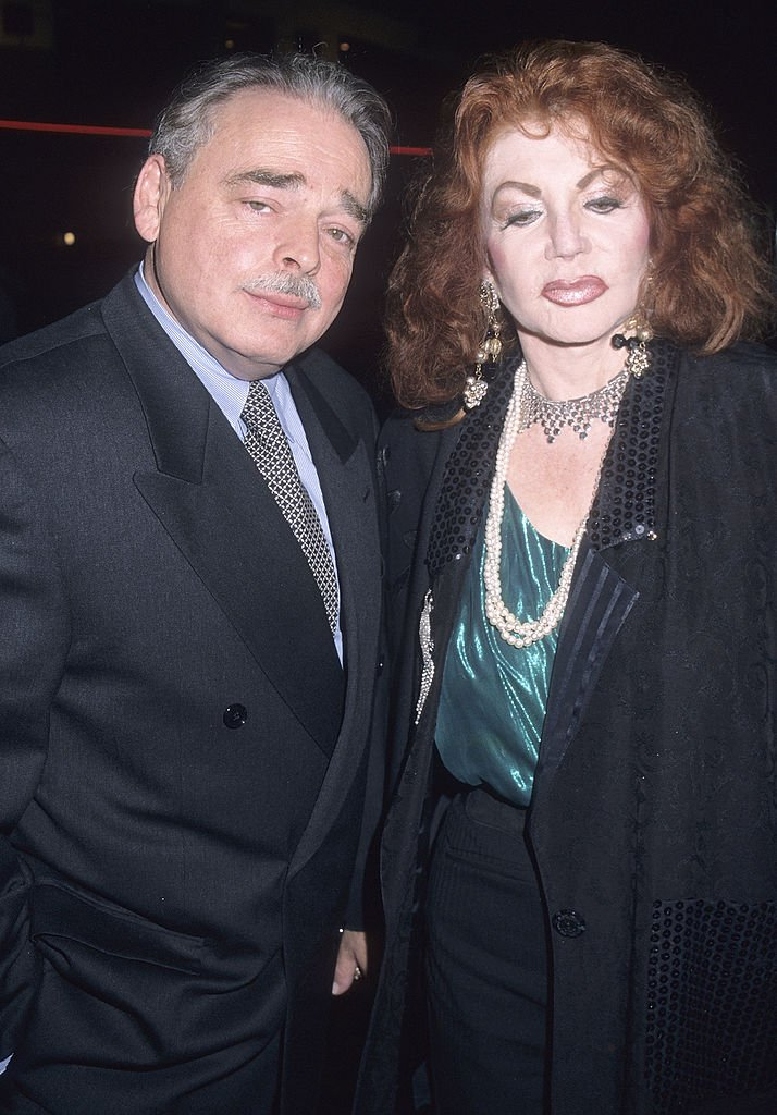 "Image Credits: Getty Images / Ron Galella, Ltd. / Ron Galella Collection | Jackie Stallone and husband Stephen Levine attend the ""Get Carter"" Westwood Premiere on October 4, 2000 at the Mann Bruin Theatre in Westwood, California."