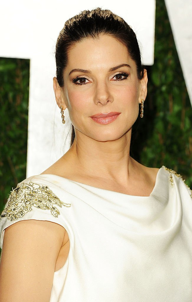 Image Credits: Getty Images / Pascal Le Segretain | Actress Sandra Bullock arrives at the 2012 Vanity Fair Oscar Party hosted by Graydon Carter at Sunset Tower on February 26, 2012 in West Hollywood, California.