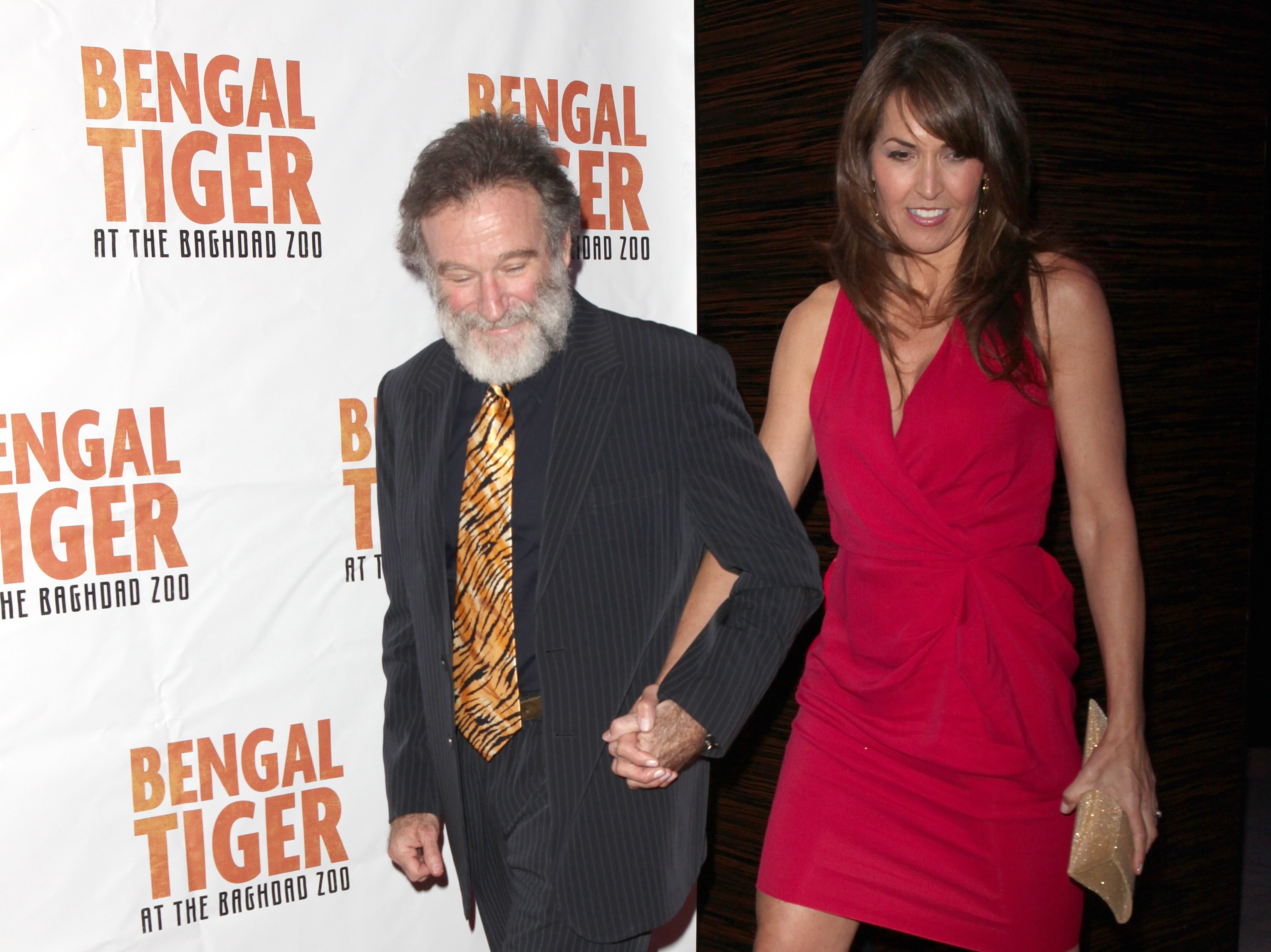 Image Credits: Getty Images / Walter McBride / Corbis | Robin Williams & Susan Schneider attending the Broadway Opening Night After Party for 'Bengal Tiger at the Baghdad Zoo' at espace in New York City.