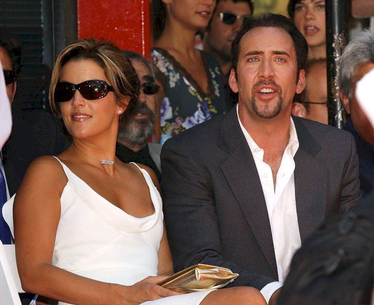 Image Credit: Getty Images / Actor Nicolas Cage and girlfriend, actress Lisa Marie Presley, sit during a hand and footprint ceremony honoring Cage August 14, 2001.