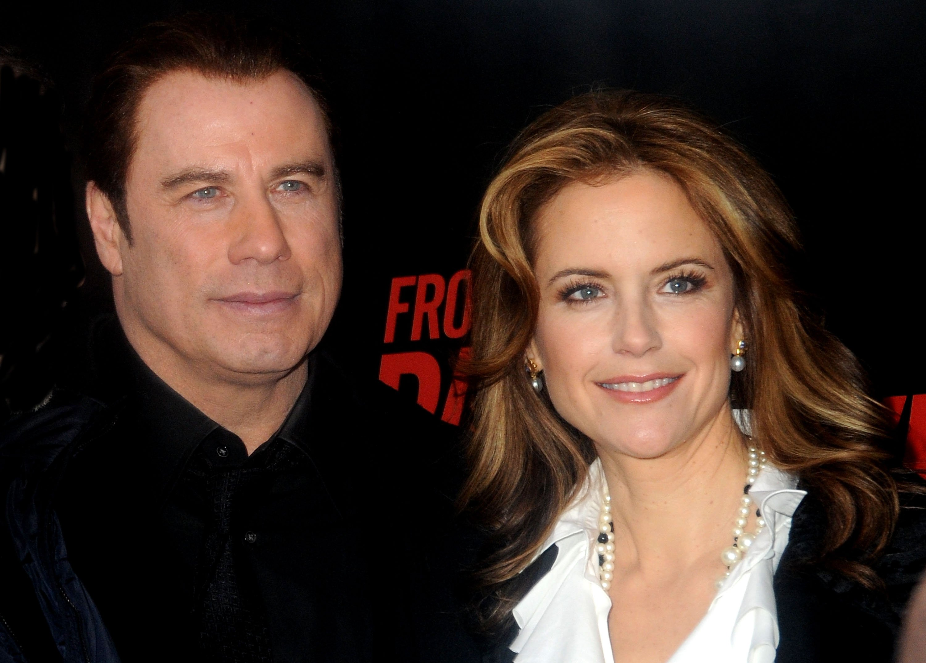 Image Source: Getty Images/John and Kelly at a movie premiere