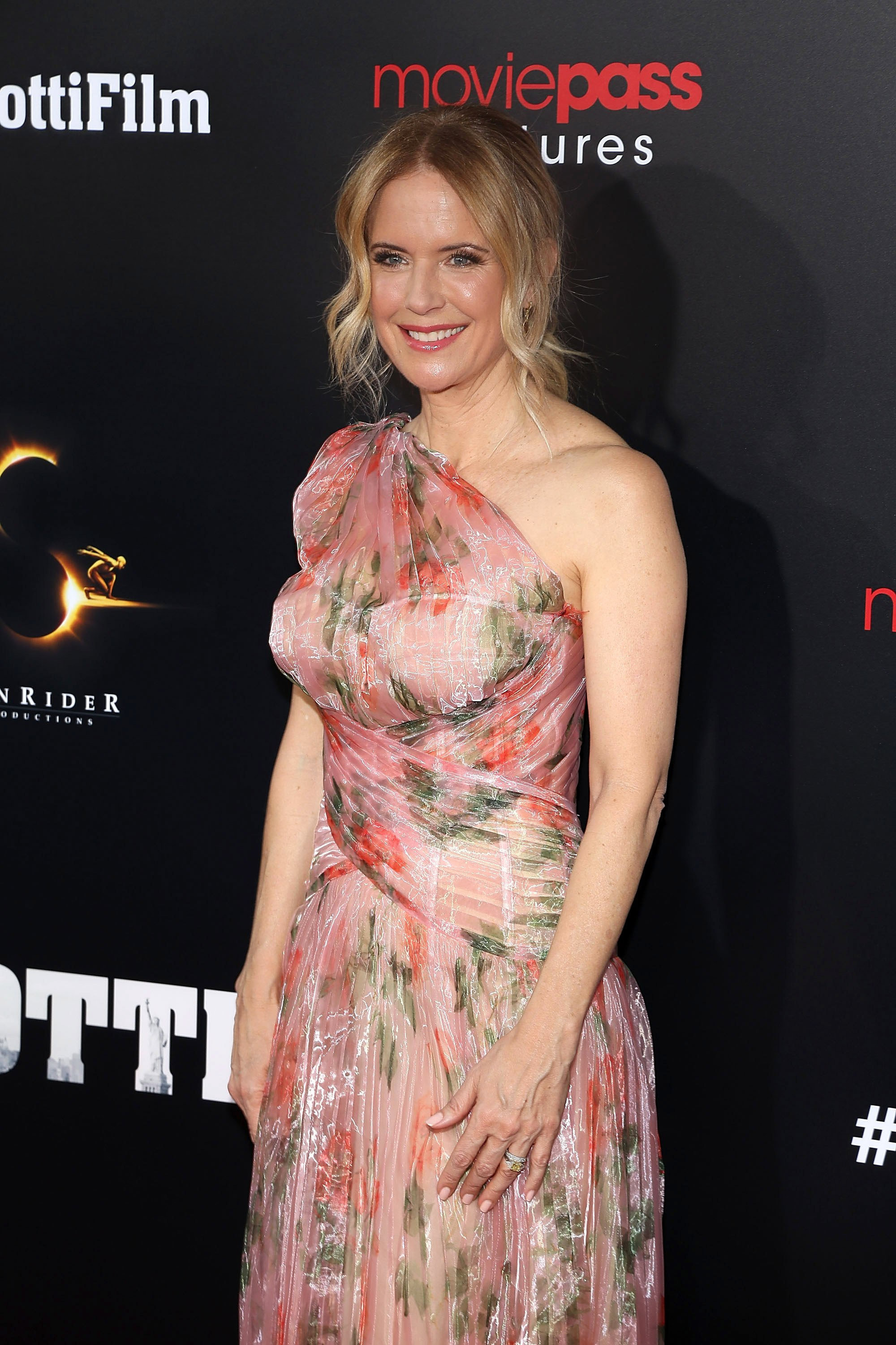 Image Source: Getty Images/Kelly at a movie premiere event