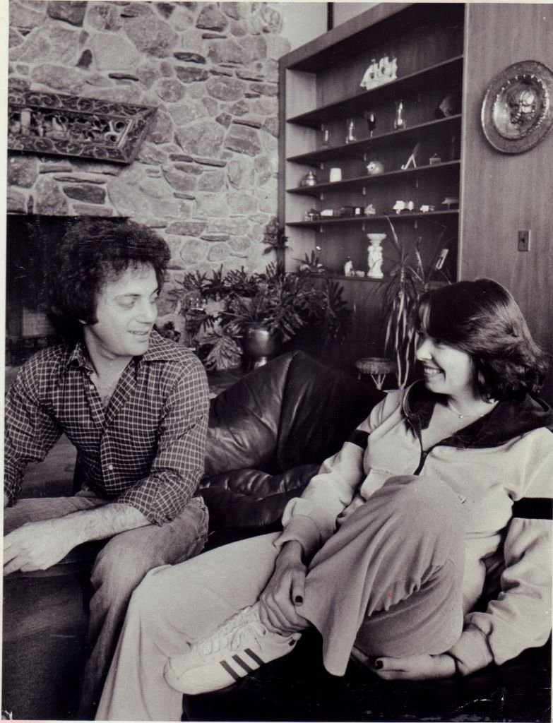 Image Credits: Getty Images / Dick Kraus / Newsday RM | Musician Billy Joel and his wife and manager Elizabeth Weber at their home in Cove Neck on December 20, 1978.