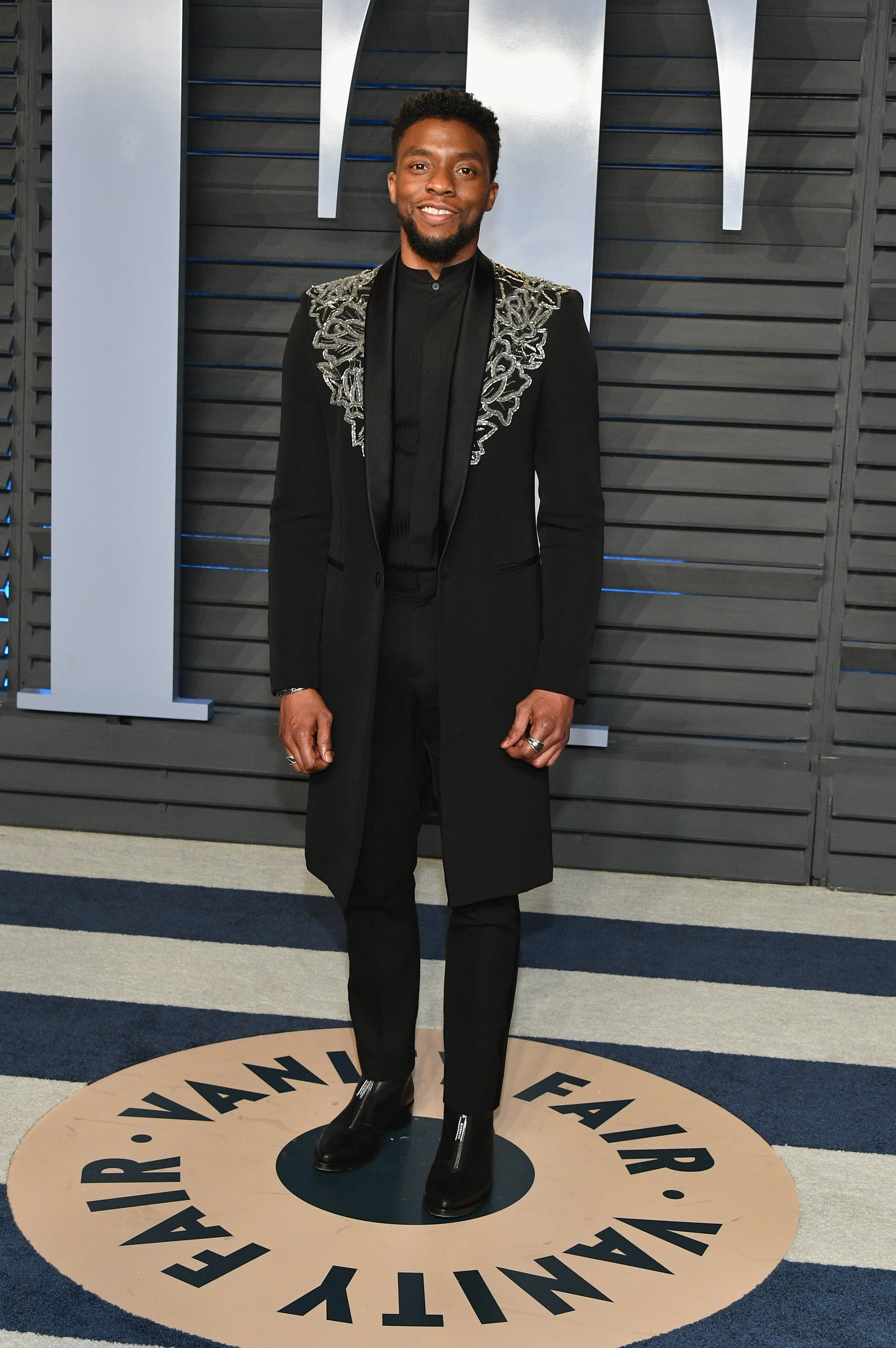 Image Credits: Getty Images / Dia Dipasupil | Chadwick Boseman attends the 2018 Vanity Fair Oscar Party hosted by Radhika Jones at Wallis Annenberg Center for the Performing Arts on March 4, 2018 in Beverly Hills, California.