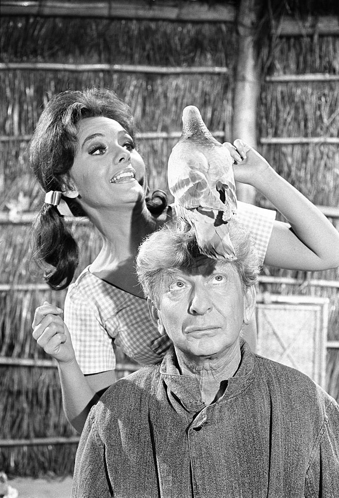 "Image Source: Getty Images/CBS Photo Archive/Gilligan's Island cast member, at left, Dawn Wells (as Mary Ann Summers) and guest star Sterling Holloway as Burt (the pigeon fancier) in the episode: ""The Pigeon."" Image dated February 6, 1967"