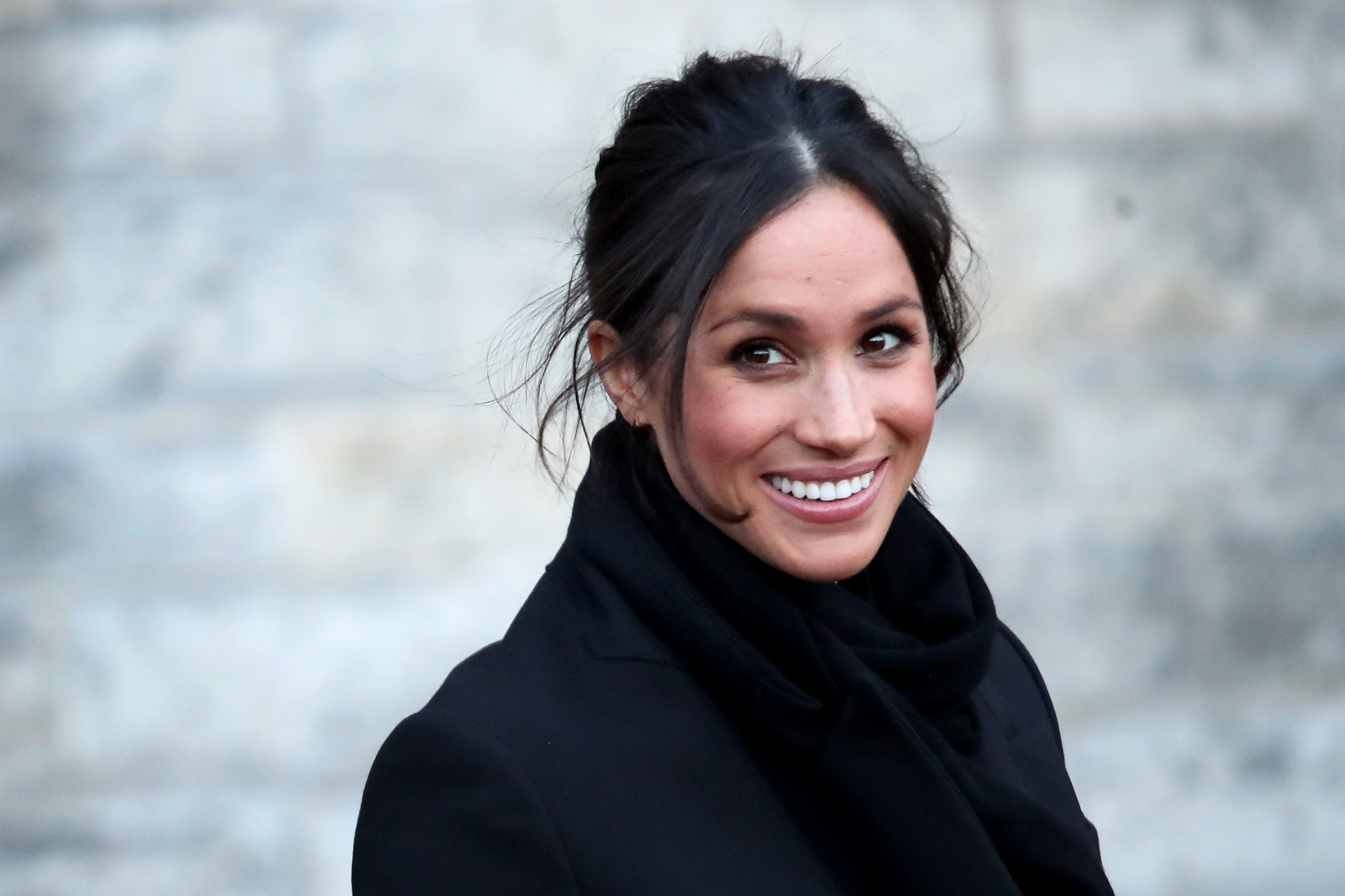 Image Credits: Getty Images / Chris Jackson   Meghan Markle departs from a walkabout at Cardiff Castle on January 18, 2018 in Cardiff, Wales.