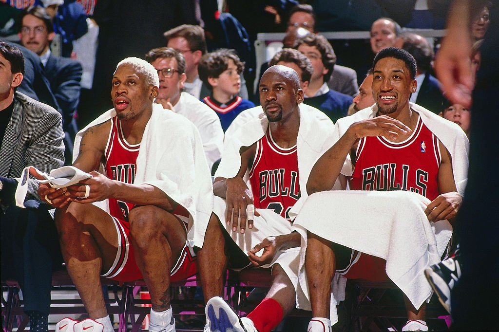 Image Credits: Getty Images / Nathaniel S. Butler / NBAE | Dennis Rodman #91, Michael Jordan #23 and Scottie Pippen #33 of the Chicago Bulls looks on against the New York Knicks on January 23, 1996 at Madison Square Garden in New York City.
