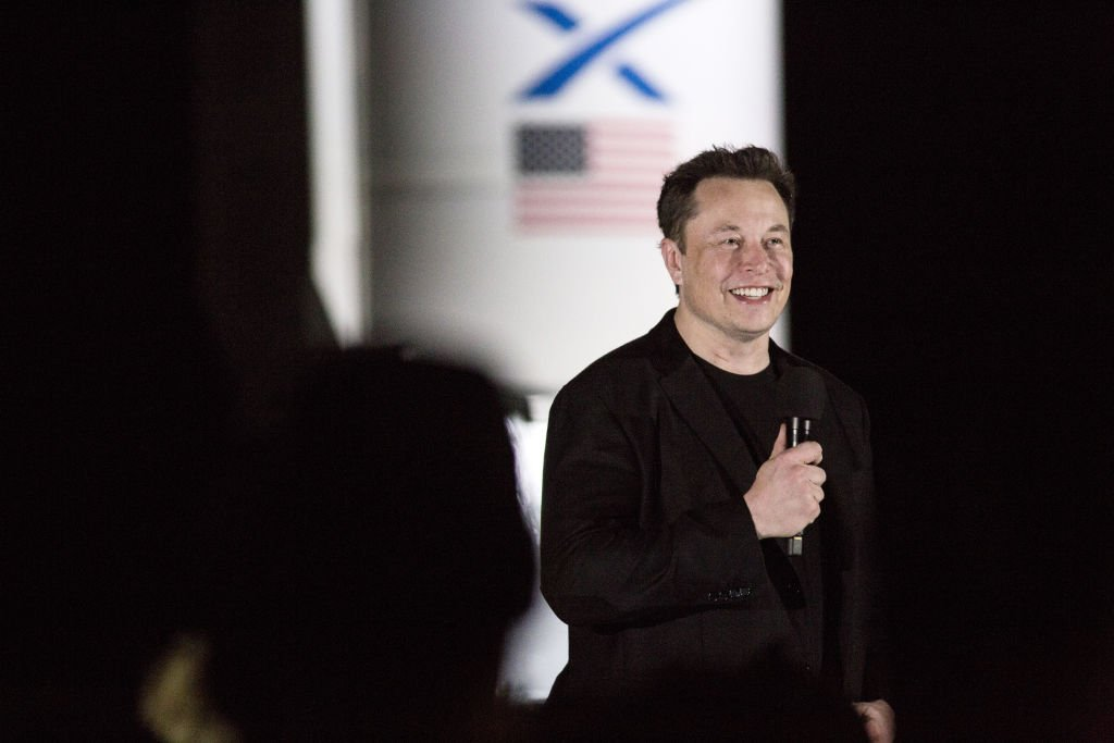 Image Credit: Getty Images / Elon Musk, chief executive officer of Space Exploration Technologies Corp. (SpaceX) and Tesla Inc., speaks during an event at the SpaceX launch facility in Cameron County, Texas, U.S., on Saturday, Sept. 28, 2019.