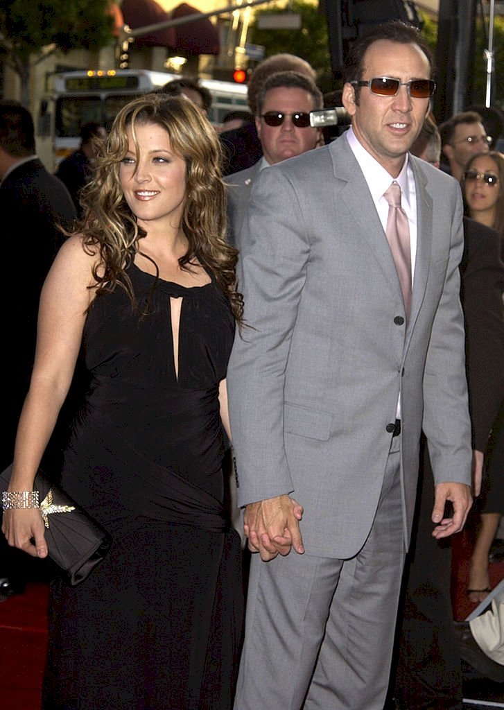 Image Credit: Getty Images / Actor Nicolas Cage and wife, actress Lisa Marie Presley.