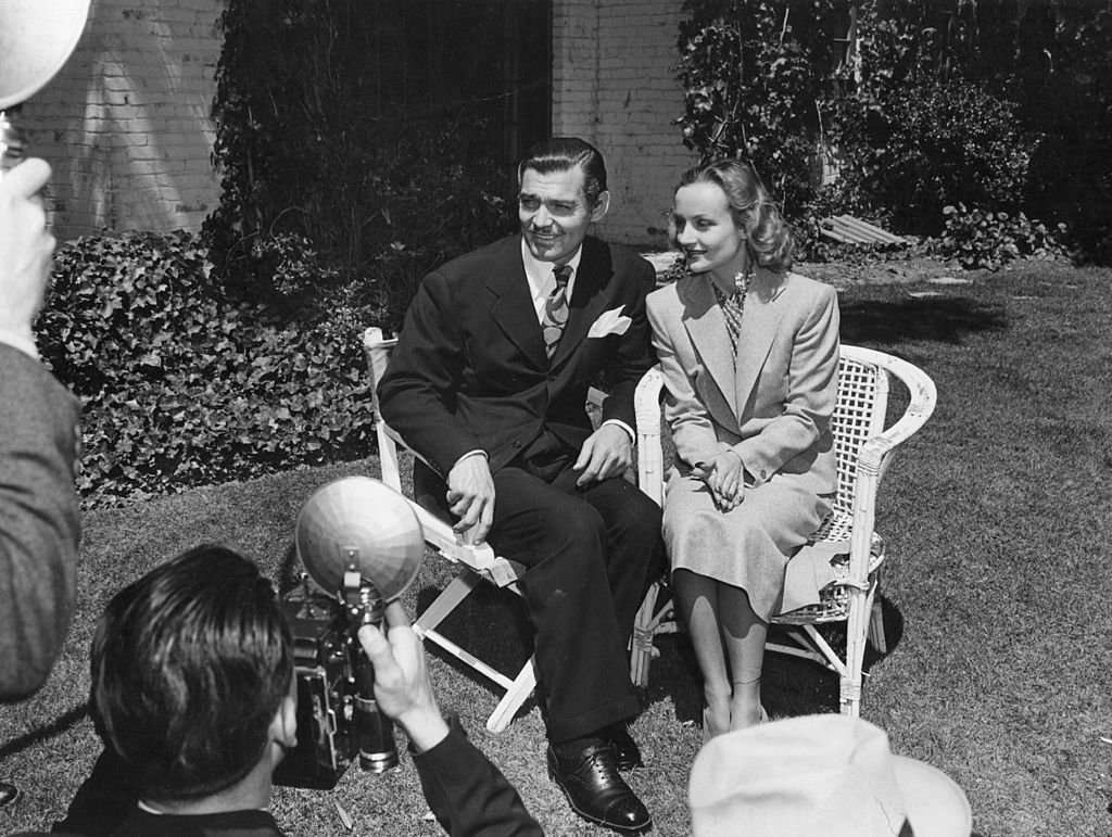 Image Credit: Getty Images / American film star Clark Gable (1901-1960) being interviewed with his third wife Carole Lombard (1908-1942) just after their marriage.