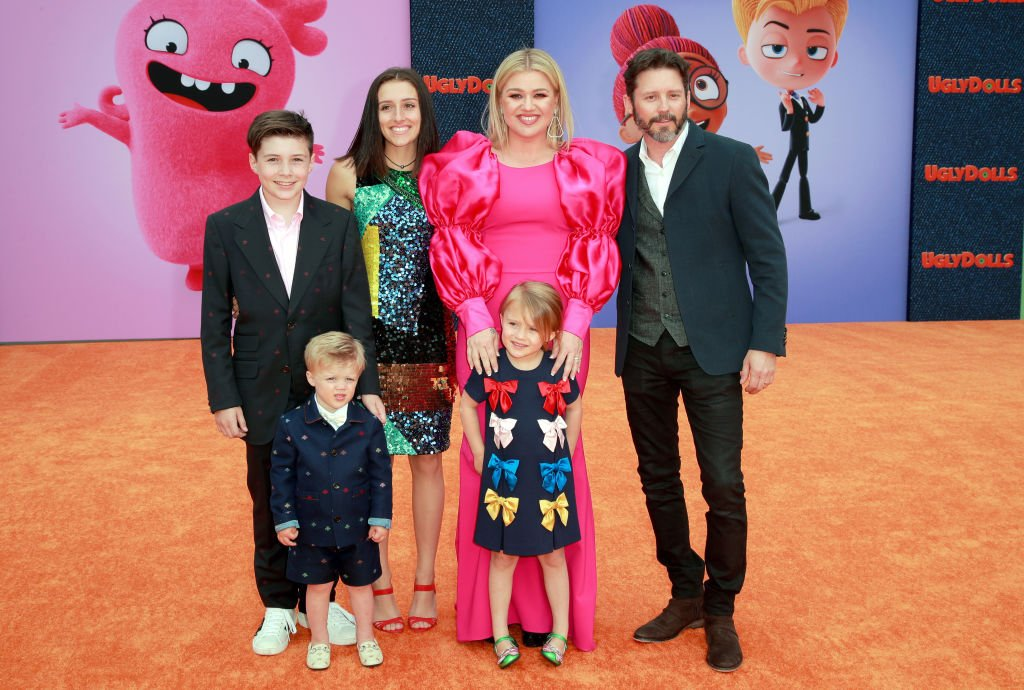 Image Credits: Getty Images / Rich Fury | Kelly Clarkson and family in 2019